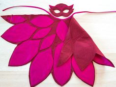 Little Owlette costume from PJ Masks for your little girl. The burgundy colored cape features magenta colored pattern just as well as the mask does.