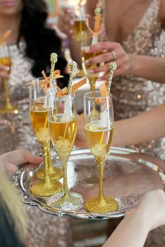 Sparkly Gold Rock Candy-Filled Champagne Drinks | Event Planning – Celebrations of Love | Uptown Theater – Kansas City, Missouri | Jana Marie Photography https://www.theknot.com/marketplace/jana-marie-photography-independence-mo-389986