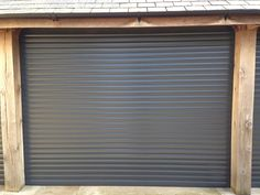 Anthracite Roller Garage Doors installed by Swan Gates Yorkshire