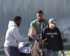 Men's basketball helping out at Buckboard Riding Academy!