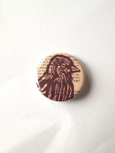 Bird on Vintage Book Page Pin Back Button by HorseAndHare on Etsy, $2.00