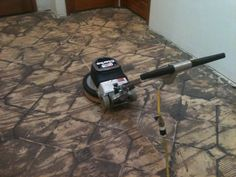 Once all of the ceramic tile had been removed the thin set needed to be sanded to create a smooth surface to lay hardwood to. I used a floor maintainer with 8 grit sandpaper.