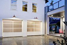 Modern garage door cedar soffits dark siding house for Wind code garage doors
