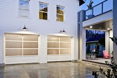 Modern garage door cedar soffits dark siding house for Clopay hurricane garage doors