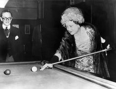 Queen Elizabeth the Queen Mother playing pool in 1961.
