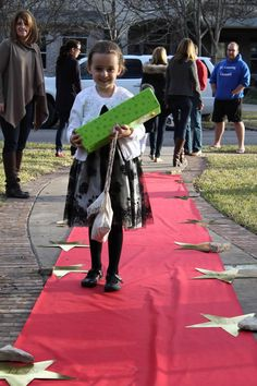 Walking the red carpet at Oscars themed party