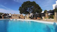 Arokaria Hideaway Suites || Located in Parikia and 100 metres from Kamares, Arokaria Hideaway Suites features a garden and a seasonal outdoor pool with sun terrace. Church of Ekatontapyliani is 5 km from the property.