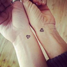 Matching tattoos. Mommy, Kelly, me. Hearts so cute!