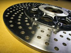 160 hole custom drilled and chamfered rotor by a former member of SOHC4.net forum. His post is down, he may be off for the racing season. (races cars and does rotor drilling on the side) Cb750, Cafe Racers, Race Cars, Racing, Motorcycle, Motorbikes, Drag Race Cars, Running, Auto Racing