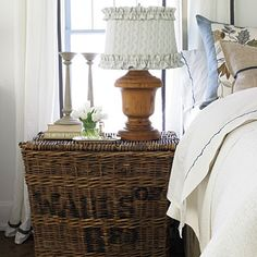 cute basket as end table, love the ruffled shade with the wooden, substantial base