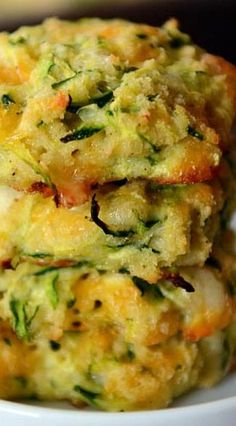 Baked Cheesy Zucchini Bites Simple and delicious, these baked cheesy zucchini bites are so easy to make and are a healthier alternative to a classic fried zucchini fritter! Vegetable Recipes, Vegetarian Recipes, Cooking Recipes, Healthy Recipes, Cooking Food, Vegan Meals, Vegan Desserts, Vegetable Side Dishes, Appetizer Recipes