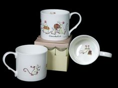 NMM181 CHOCOHOLICS  a Bone China Mug decorated by Anita Jeram for Two Bad Mice Cards and Ceramics - price £12.50 (Gift Boxed)