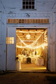 This white barn with infinite lights strung inside looks like the perfect venue.