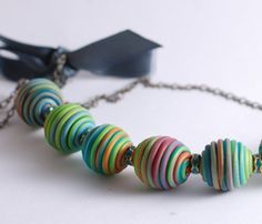 Not my usual but I absolutely love the use of color in these polymer clay beads!! Congrats to Ilze from Rotdaris.etsy.com on her treasury contest win!