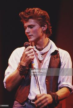 Singer Morten Harket performing with Norwegian pop group A-ha, UK, circa 1987.