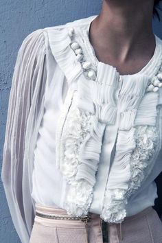 Beautiful Textures romantic white shirt with a mixture of ruffles and gathering - close up fashion details
