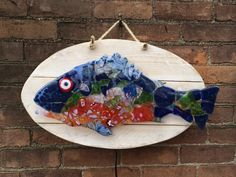 Fused glass fish backlit with neon skeleton on Etsy, $400.00