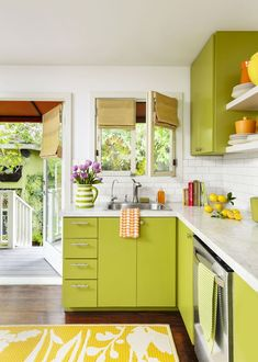 Lime-green cabinets and backyard windows bring the nearby garden inside, creating a zesty feel in this sleek, bright kitchen. Paint (cabinets): Dunn-Edwards's Palm Frond Lime Green Kitchen, Green Kitchen Decor, Green Kitchen Cabinets, Kitchen Cabinet Colors, Painting Kitchen Cabinets, Kitchen Paint, Home Decor Kitchen, Lime Green Decor, Kitchen Ideas
