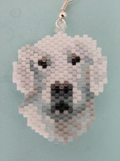 Hand Beaded Snow Retriever Dog dangling earrings