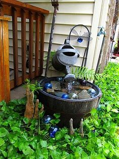 FanScape Kirk Willis Watering can and whiskey barrel water feature