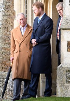 Prince Harry stood outside the church with his father, Prince Charles after attending the ...