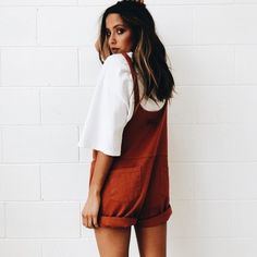 Cute red overall shorts with white shirt.