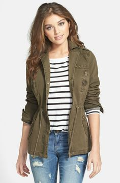 Army jacket, striped shirt, jeans