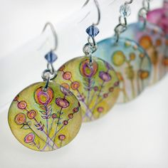 Shrinky dink earrings...Enchanted Earrings by The Intuitive Garden. All of her wearable art features original drawings, digital illustrations and/or photographs. American Made. 2013 Buyers Market of American Craft. americanmadeshow.com