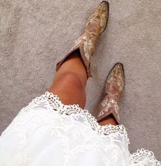 Cowgirl**.....rockimg the detailed cowboy boots and lace white dress country girl on a dirt road