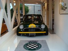 Extreme wide classic Mini Cooper! Nice garage by the way... :)