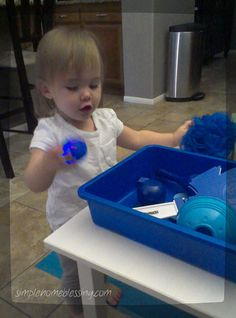 One Year Old Preschool, unit on colors (blue), sensory bin and blue activities