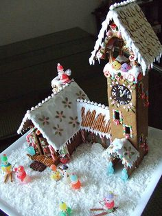 GINGERBREᎯD HOUSE~I like the pretzel skis and the birds in the cuckoo clock tower of this gingerbread house! Holiday Treats, Christmas Treats, Christmas Baking, Christmas Cookies, Holiday Fun, Christmas Holidays, Gingerbread House Parties, Christmas Gingerbread House, Gingerbread Man
