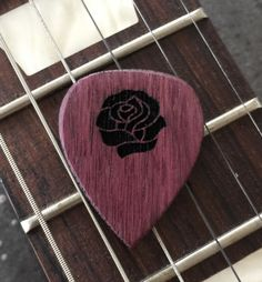 We just shipped this beautiful rose guitar pick out to a customer. It can be found at our website laserpickusa.com We offer many great exotic and domestic hardwood choices with all of our premium guitar picks. Every wooden guitar pick we make is handmade in the USA. We also offer custom options as well. Thank you, Howard
