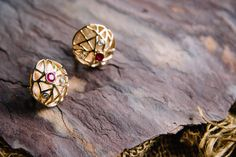 The 18K gold earrings featured an actual 18K 2014 penny on the back [ to memorialize the spe Two 0.60 diamond cut bezel set rubies, complemented by four 0.15 full cut bezel set diamonds