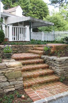 Stone walls with brick steps. #mainstreetnursery #stonewalls #bricksteps