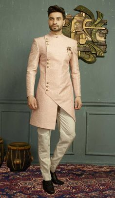 Buy Royal Pink Asymmetrical Indo Western Sherwani Online from Bodylinestore at best price. Select wide range of men's wedding sherwani, designer Sherwani for groom, traditional sherwani, jodhpuri Sherwani, sangeet sherwani and more. Mens Indian Wear, Mens Ethnic Wear, Indian Groom Wear, Indian Men Fashion, Indian Man, Mens Wedding Wear Indian, Mens Fashion, Baby Boy Ethnic Wear, Groom Fashion