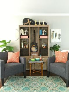 Love the style and styling of this bookcase for a teen boy's room with guitar, trophies, jar of billiard balls, baskets and boxes to store stuff.  Also love the colors.