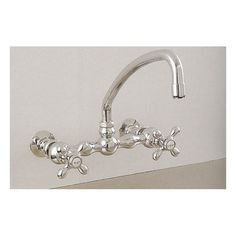 Wall Mount Faucet with Curved Spout by Strom Plumbing - Metal Cross Handles. This faucet complies with CA and VT AB 1953 Low Lead requirements IAPMO Certif