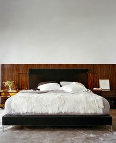 New York based Rees Roberts + Partners mixed contemporary chic with a little mid century charm to achieve this undeniably manly bedroom.