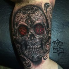 This beautiful skull was tattooed by Big Gus.