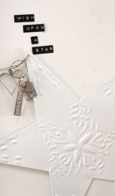 use paintable wallpaper and over cereal box stars with ribbon hangers