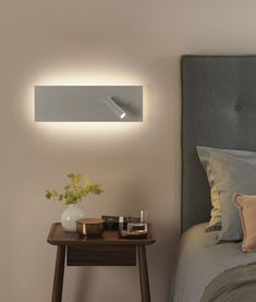 A rectangular wall light backlit with LEDs and a single adjustable reading light - perfect for bedside installation. From Lighting Styles the specialist lighting store. Astro Lighting, Lounge Lighting, Cove Lighting, Outdoor Wall Lighting, Lighting Store, Bedside Wall Lights, Bedside Lighting, Bedroom Lighting, Interior Lighting