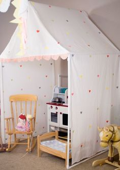 """Could be made with white PVC tbing in a more """"boyish"""" fabric. #diyindoorplayhouse #buildachildrensplayhouse"""
