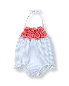 For the sweetest swim time, our striped design features 3D blossoms in a vivid hue. Ruffle accents and clasp halter with permanent bow finish the pretty piece.