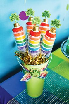 Rainbow push pops with cupcakes baked in a mini push pop pan.