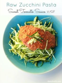 Raw Zucchini Pasta with Sweet Tomato Sauce. http://www.damyhealth.com/2013/03/raw-zucchini-pasta-with-sweet-tomato-sauce/