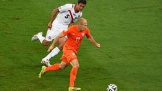 Arjen Robben of the Netherlands controls the ball against Celso Borges of Costa Rica
