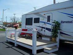 EZ Life RV - Love this deck area. Wonder if we could make something similar to this? Then maybe get a new awning put on the RV?