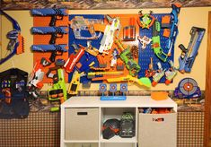An awesome Nerf wall set up by Anna and her son Sam 🔫 Easy storage and clean up for kids and thier toy guns with Wall Control Pegboard. Nerf Gun Storage, Metal Pegboard, Tool Organization, Easy Storage, Clean Up, Mj, Birthday Ideas, Baby Kids, Kids Room