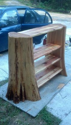 Tree stump bookcase. I'd want to do one much taller, but this would be really pretty in a rustic cabin.